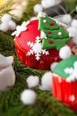 Red cupcake with Christmas symbol — Stock Photo