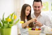 Daughter and father having fun with Easter eggs — Stock Photo