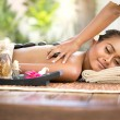 Beautiful woman getting spa hot stones massage in spa salon — Stock Photo #68802119