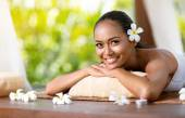 Beautiful smiling woman relaxing after massage — Stock Photo
