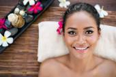 Smiling Asian woman on massage desk  — Stock fotografie