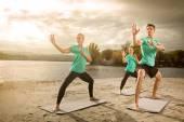 Group practicing yoga — Stock Photo