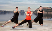 Three young people exercising — 图库照片