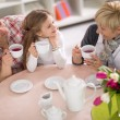 Mother, grandmother and daughter together on tea party — Stock Photo #73071297