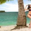 Young attractive woman  at tropical resort — Fotografia Stock  #76632243
