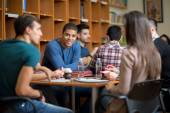 Latino American student socializing with friends — Stock Photo