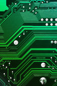 Green computer motherboard background — Stock Photo
