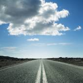 Long road on a sunny day — Stock Photo