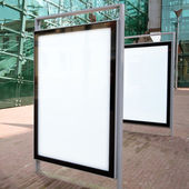 Blank ad billboards on a street — Stock Photo