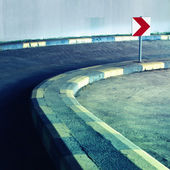 Curvy road with sign — Stock Photo