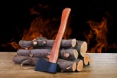 Firewood logs and axe — Stock Photo