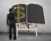 Sketching money symbol on blackboard — Stok fotoğraf