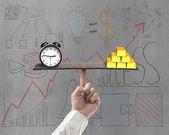 Clock and bullion balance on plank — Stock Photo
