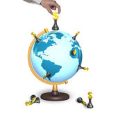 Hand holding chess with terrestrial globe — Stock Photo