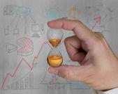 Man hand holding hourglass — Stock Photo