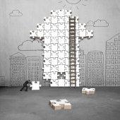Businessman pushing puzzle with arrow shape — Stock Photo