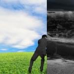 Businessman pushing away stormy sea wall — Stock Photo #73354717