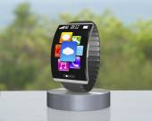 Dark gray curved screen smartwatch on showcase with metal watchb — Stock Photo