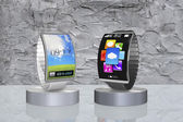 Pair colorful curved screen smartwatch with metal watchband on s — Stock Photo