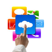 Hand pointing at cloud computing with colorful app icons — Stock Photo