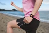 Sport female wearing bright pink watchband bent touchscreen smar — Stock Photo