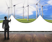 Businessman pulling open wind turbines curtain covered blank whi — Stock Photo