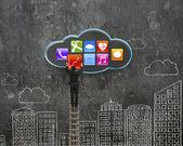 Climbing businessman get app icon from black cloud — Stockfoto