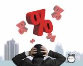 Businessman hand holding head with red percentage signs and cloc — Stock Photo