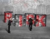 Boss speaker yelling employee pushing jigsaw blocks red RISK wor — Stock Photo