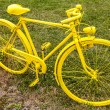 Old Yellow Bicycle in a Field — Stock Photo #53350785