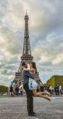 Couple in Front of Eiffel Tower — Stok fotoğraf