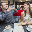 Couple Taking Photos in Cafe — Stock Photo #55373065