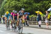 Group of Cyclists Riding in the Rain — ストック写真