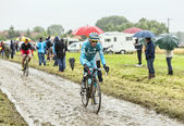 The Cyclist Michele Scarponi on a Cobbled Road - Tour de France  — Stock Photo