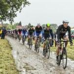 The Peloton on a Cobbled Road- Tour de France 2014 — Stock Photo #57907117