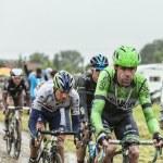 The Peloton on a Cobbled Road- Tour de France 2014 — Stock Photo #57907119