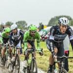 The Peloton on a Cobbled Road- Tour de France 2014 — Stock Photo #57907121