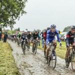 The Peloton on a Cobbled Road- Tour de France 2014 — Stock Photo #57907123
