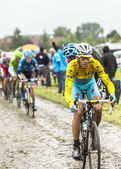 Vincenzo Nibali - Yellow Jersey on a Cobbled Road — Stock Photo