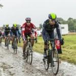 The Peloton on a Cobbled Road- Tour de France 2014 — Stock Photo #67858207