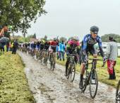 The Peloton on a Cobbled Road- Tour de France 2014 — Stock Photo