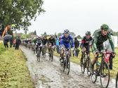 The Peloton on a Cobbled Road- Tour de France 2014 — Stock Photo