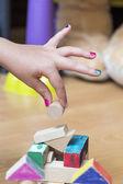 Little girl's hand building something — Stock Photo