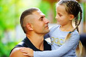 The father embraces the daughter — Stock Photo