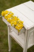 Vintage table with flowers in coffer — Stock Photo