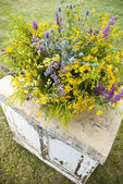 Luxuriant wildflowers bouquet on the old vintage table — Stock Photo