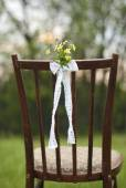 Close up of flower decorated on wedding vintage chair — Stock Photo