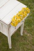 Old vintage table and flowers — Zdjęcie stockowe