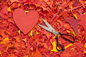 Valentine day paper cuttings background with scissors — Stock fotografie