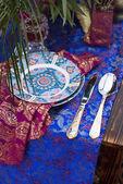 Wedding table arrangement in desert sand of Morocco stile — Stock Photo